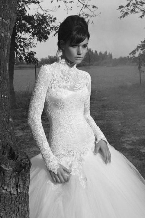 lace turtleneck wedding gown with long sleeves and a tulle skirt