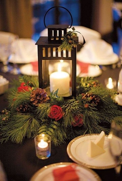 lantern on a pine wreath with red roses and pinecones