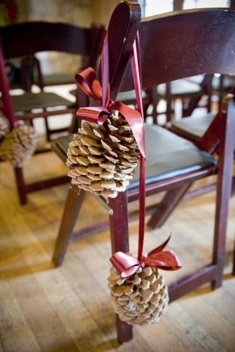 large pinecones with pink ribbon for chair decor