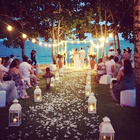 lights and candle lanterns for an outdoor coastal wedding