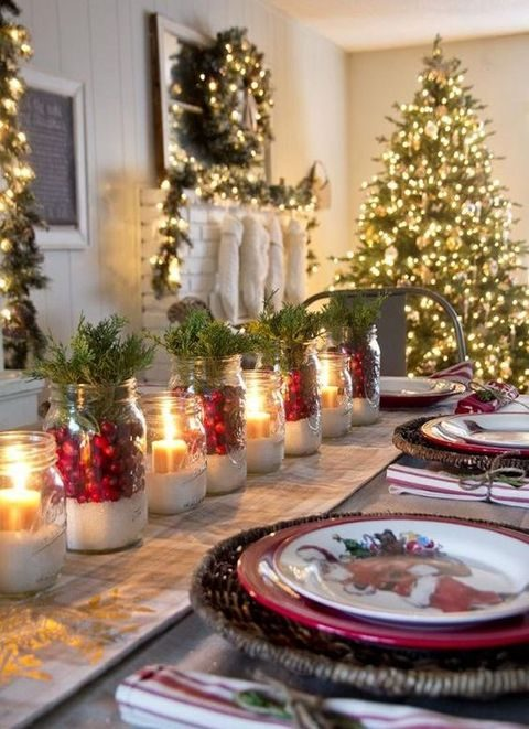 lit up tree, wreaths and a garland and candle lanterns for the tables
