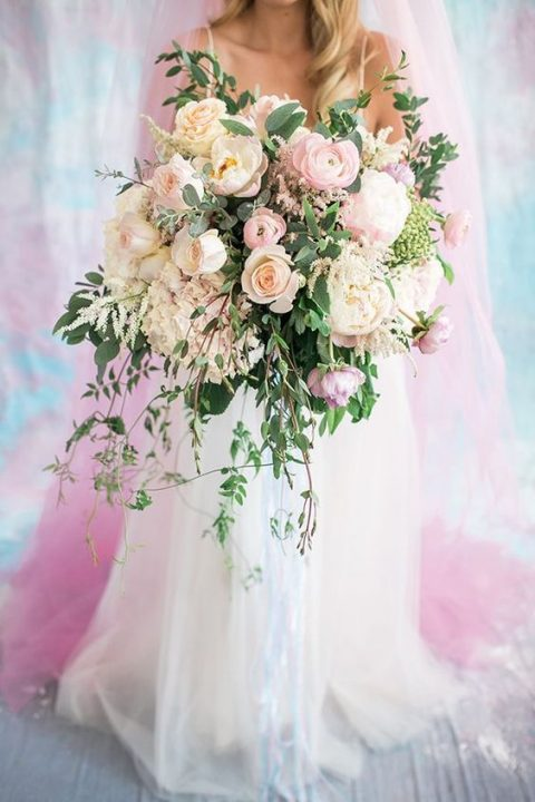 lush blush bouquet included peonies, roses, ranunculi, hydrangeas, astilbes, and greenery