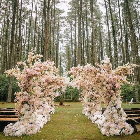 lush blush flower ceremony setting in the forest