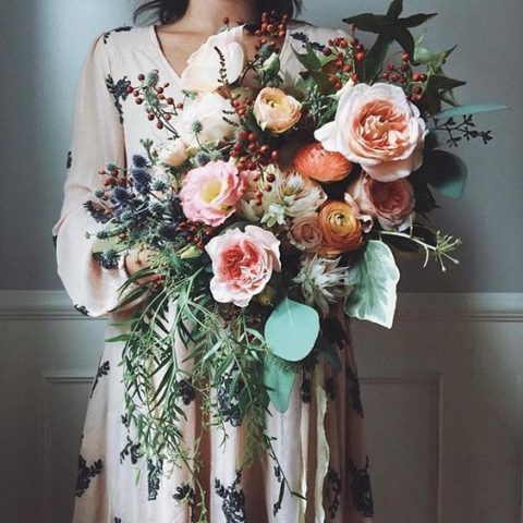 lush peach and blush toned wedding bouquet