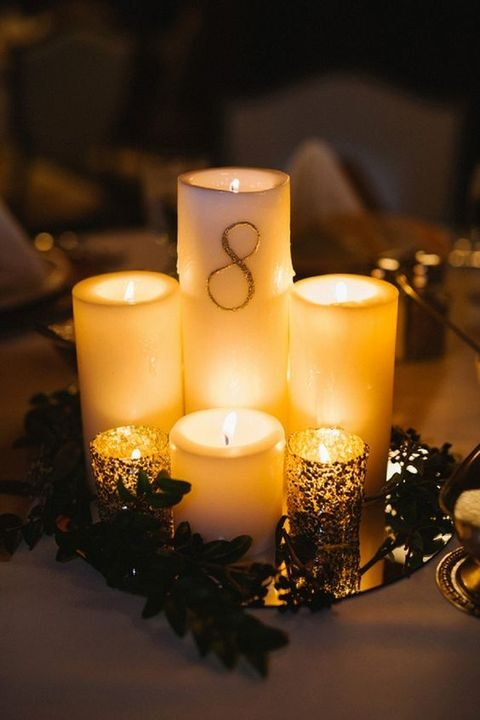 make a pillar candle centerpiece and write numbers on them