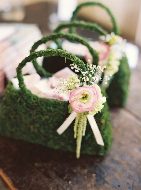 moss purses with flowers instead of traditional baskets