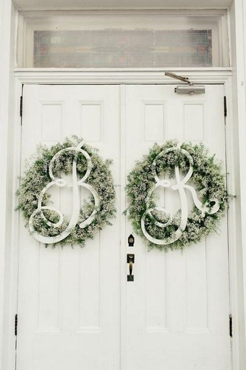 pale evergreen wreath with letters for venue door decor