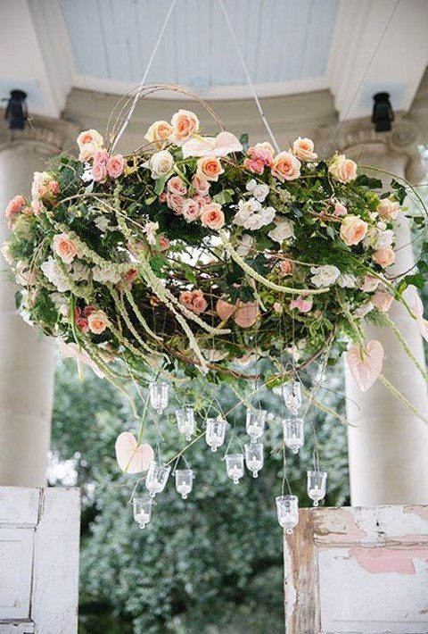 peach-and-pink roses chandelier, hanging candles suspended