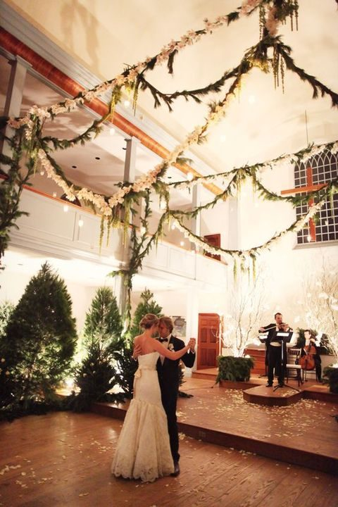 place faux fir trees in your reception for a festive atmosphere