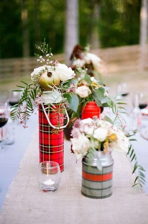 plaid thermos bottles can work as vases for a rustic or camping wedding