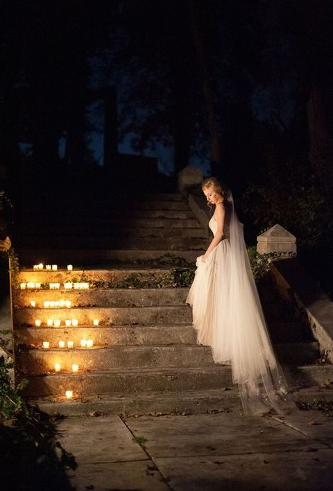 romantic steps decor with candles, a bride standing there