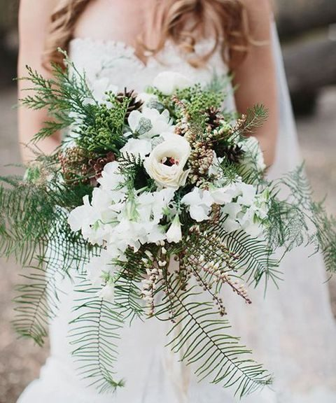 rustic wedding bouquet with ferns, pieris, pinecones, and evergreens