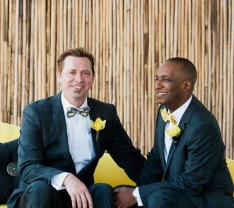 same black suits with bow ties and yellow boutonnieres