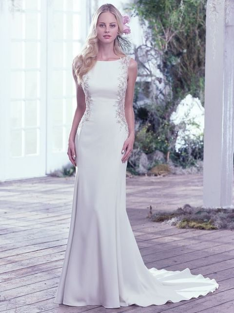 sheath bateau wedding dress with bead decor on the sides by Maggi Sottero