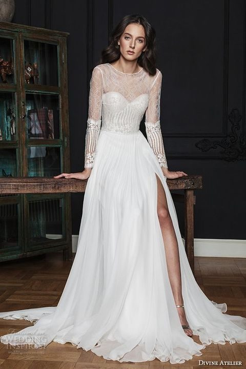 sheer bateau wedding dress with long sleeves and a flowing skirt