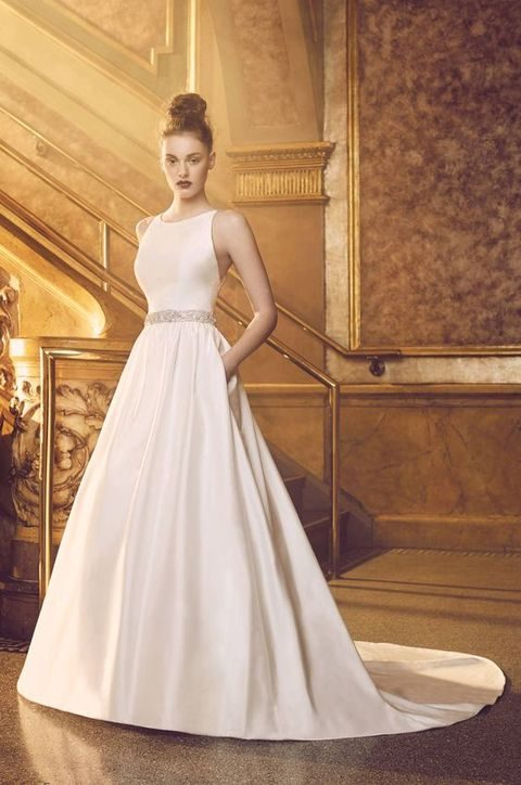 sleeveless bodice with a bateau neckline, double beaded spaghetti straps, and full skirt