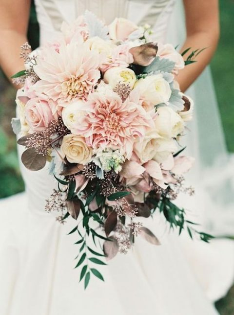 stunning blush and cream bouquet with green leaves