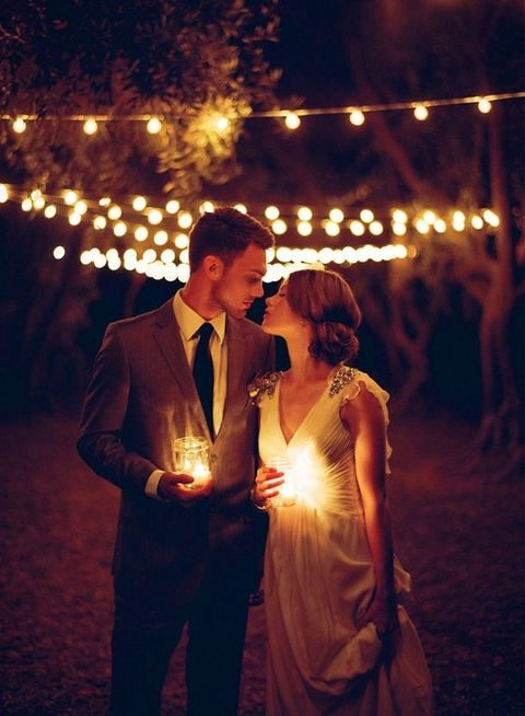 the couple holding candle lanterns