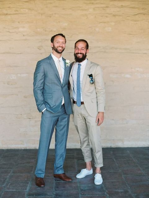 the suit of one groom matches the tie of the second groom and vice versa