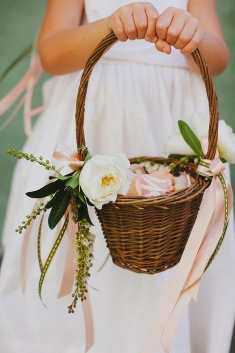 traditional flower girl basket with ribbon and petals