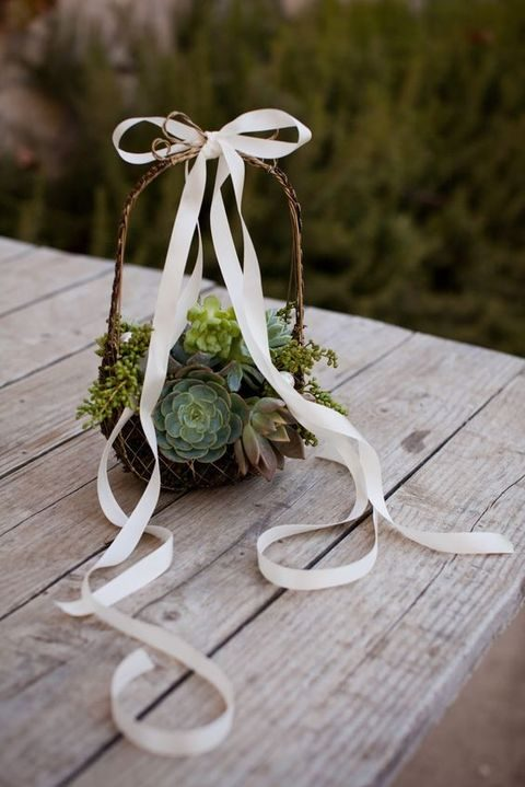 vine bakset covered with moss and with ribbon