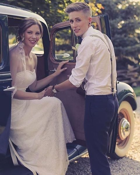 vintage-styled couple in a strapless ivory gown and pants, a white shirt and suspenders