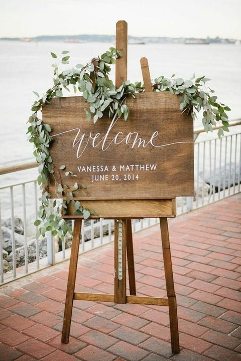 wedding sign decorated with eucalyptus