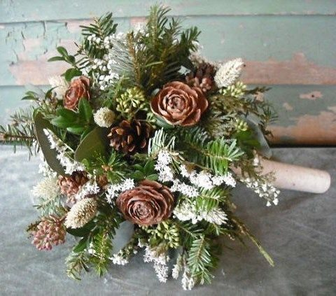 wintry bouquet with pinecones, evergreen branches