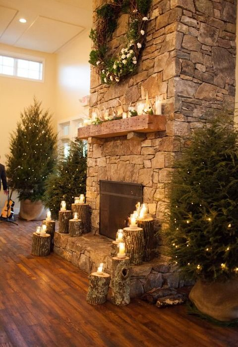 wood logs, small fir trees and lots of candles look awesome for a rustic wedding