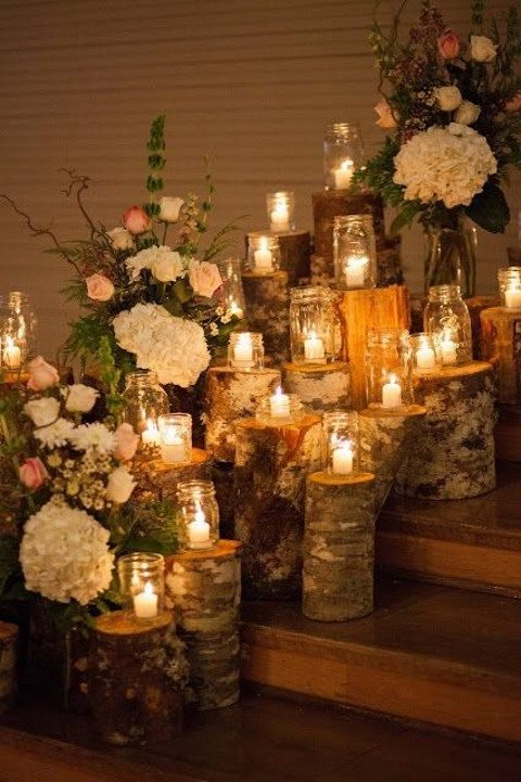 wooden logs as stands for candle holders