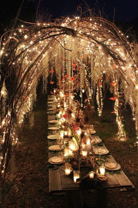 woodland wedding reception with lots of lights and crystals that reflect them