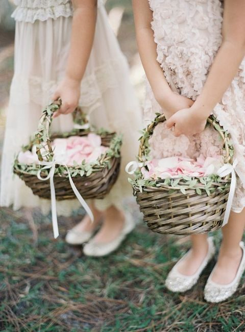 woven baskets with greenery and ribbon