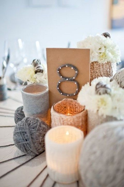 yarn balls and table numbers with nails