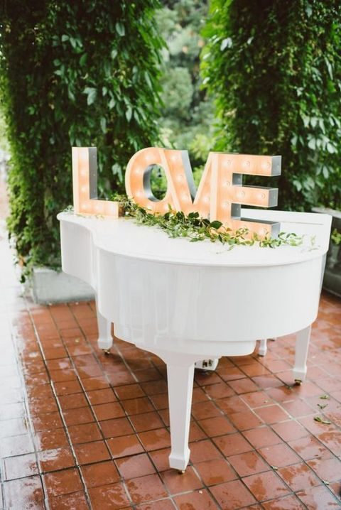 LOVE marquee letters with greenery