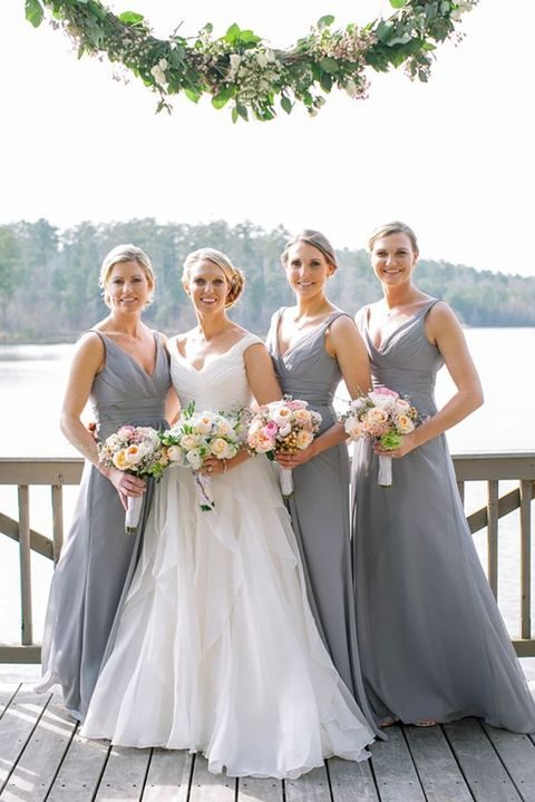 V-neck bridesmaids' dresses and pink bouquets