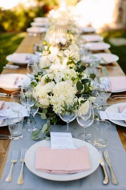a beautiful spring tablescape with ivory blooms, a gray table runner and blush napkins