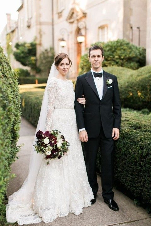 a black tuxedo and an elegant lace long sleeve dress