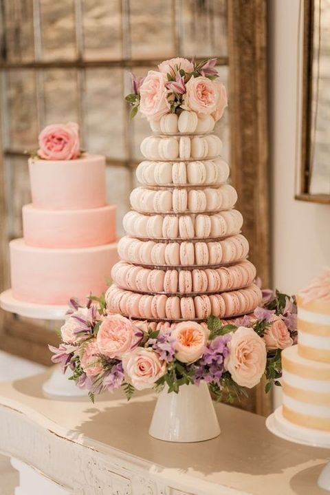 a blush macaron tower and a blush cake for the dessert table