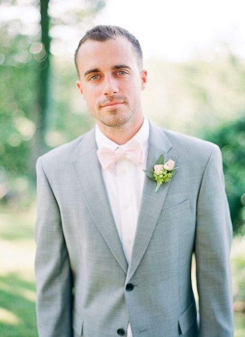 a dove grey suit, a blush bow tie and a blush bloom boutonniere