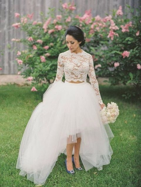 a lace top with long sleeves and a high low tulle skirt