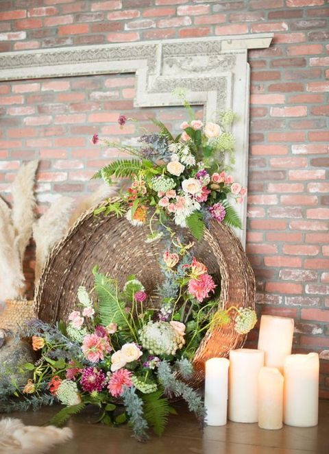a large boho basket with flowers for decor