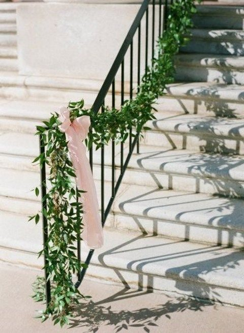 a simple greenery garland with a blush bow will make your stairs romantic