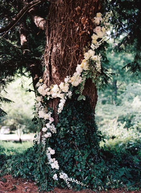 a white floral garland to cover the tree at the ceremony spot