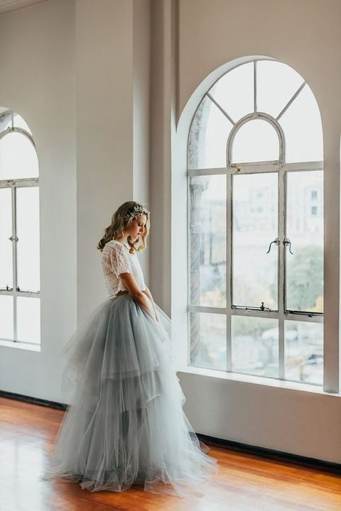 a white lace top and a grey layered tulle skirt