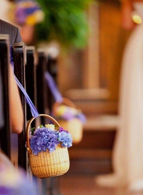 aisle decor with baskets filled with flowers