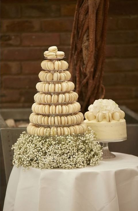 an ivory macaron tower and a macaron topped cake