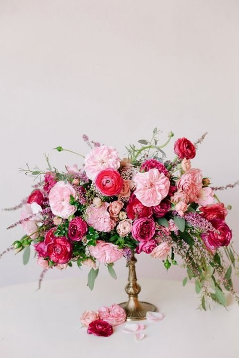 beautiful fine art floral centerpiece in pink and hot pink