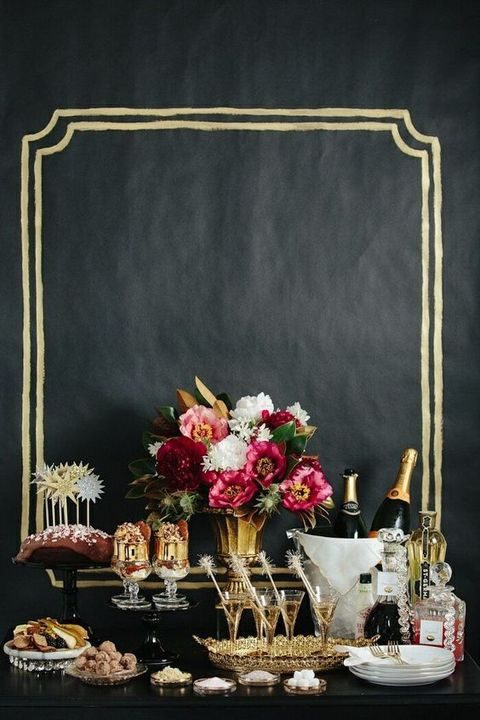 black and gold shower decor, adorable desserts and bold flowers