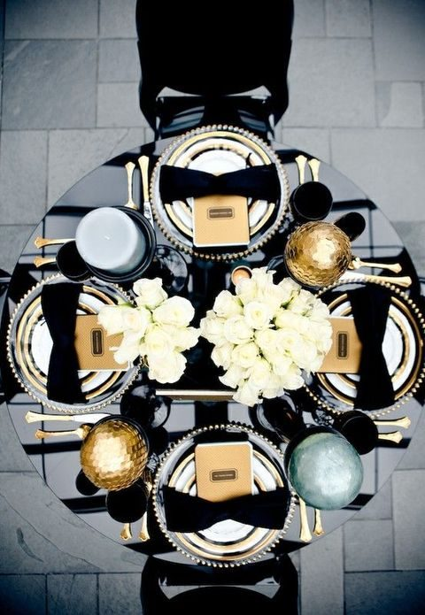 black and gold table with white flower decor