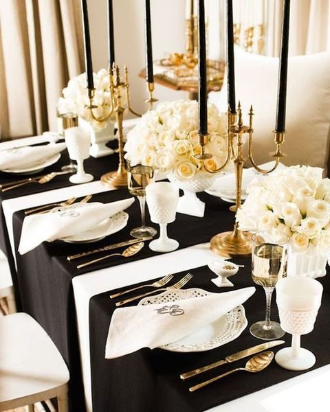 black and white table decor, gold utensils and candle holders